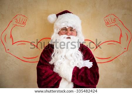 Strong Santa Claus senior man. Christmas holiday concept - stock photo