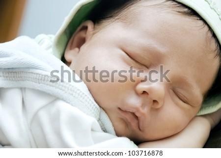 Strong sleeping newborn child - stock photo