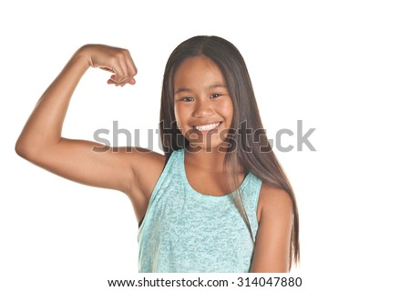 Strong tween girl flexing her arm with a full healthy smile    Image isolated on white