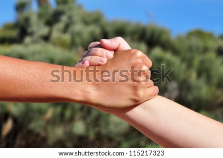 Strong united hands shake