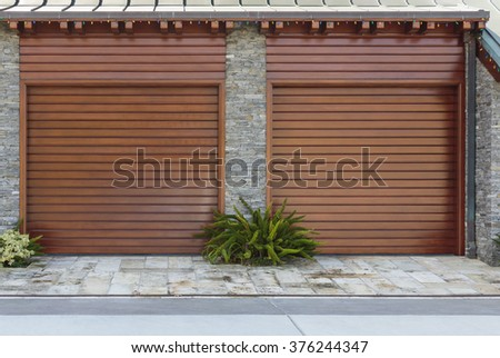 strong vertical lines with landscape two single car garage doors