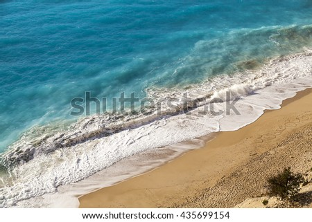 Strong waves crash over the beach, view from the top top waves view sand beach top waves view sand beach top waves view sand beach top waves view sand beach top waves view sand beach top waves view - stock photo