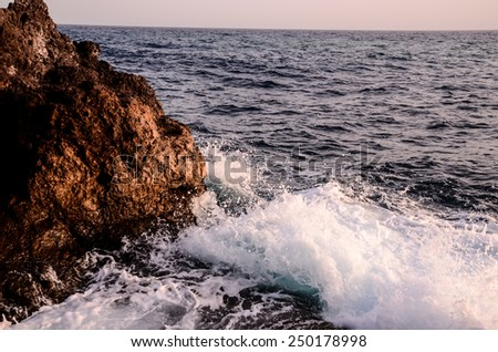 Strong Waves Crashing on the Volcanic Coast in Tenerife Canary Islands - stock photo