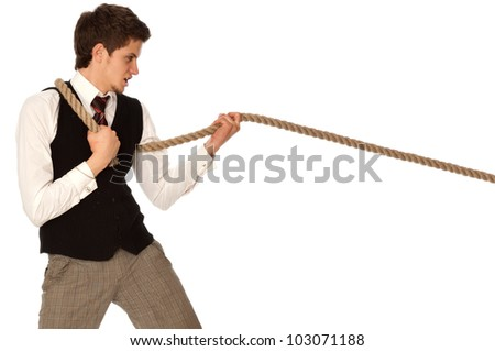 strong-willed man pulling of a rope and wins as a symbol of business success - stock photo