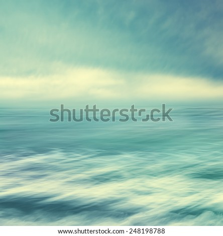 Strong winds and stormy conditions over the Pacific ocean.  Seascape made with blurred panning motion and cross-processed colors. - stock photo