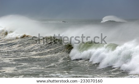 Strong windy white waves near the portuguese coast. - stock photo