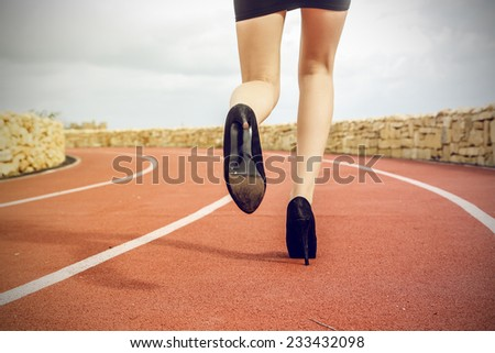 Strong woman running  - stock photo