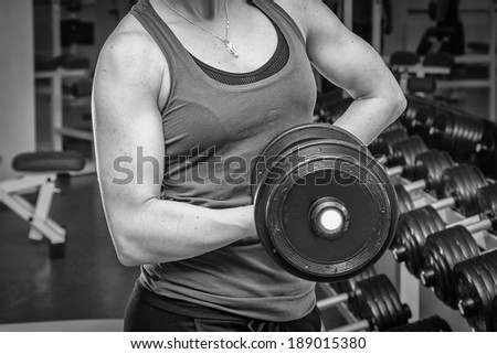 strong woman with dumbbells