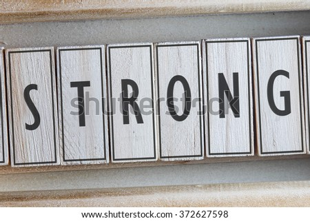 STRONG word on wood blocks concept - stock photo