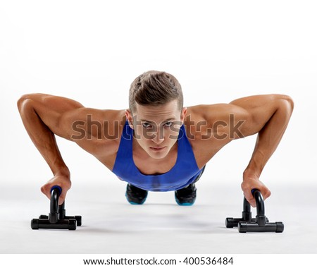 Strong young athlete doing push-ups. Sports concept.  - stock photo
