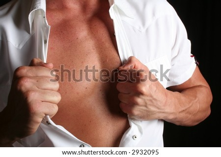 strong young  taking his shirt off - stock photo