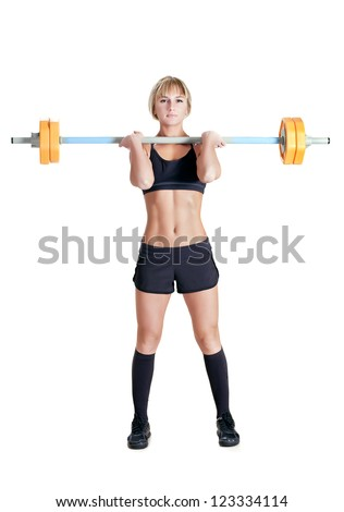 strong young woman with barbell isolated - stock photo