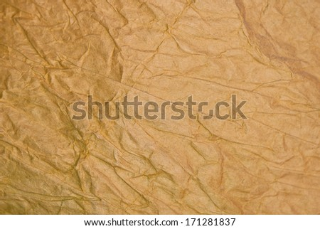 strongly crumpled brown paper background