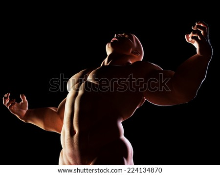 Strongman, hero showing his muscular body in winner, alpha male position. Strenght, power, body building. - stock photo