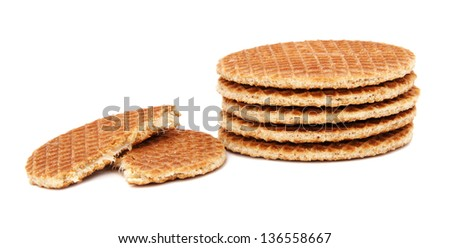 Stroopwafels, Dutch caramel waffles piled up, with one broken in half, isolated on a white background