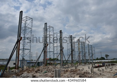 Structural steel column factory under construction with sky background