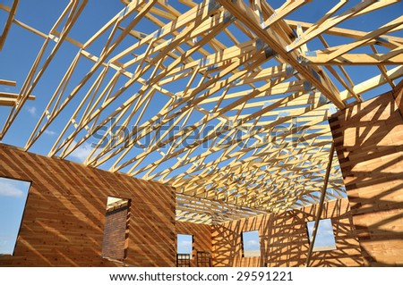 Structure of a wooden house under construction, in French. - stock photo