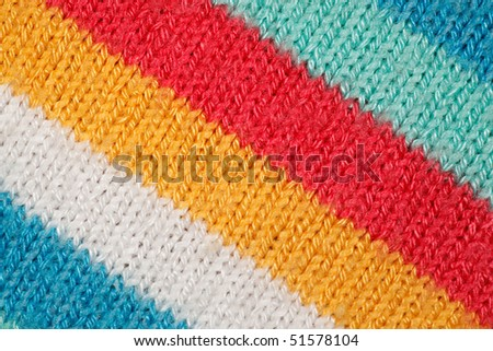 Structure of fabric close up. Bright colored strips on diagonal. - stock photo