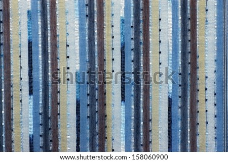 Structure of mesh fabric for a background, points and vertical strips of various color - stock photo