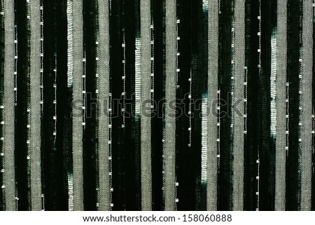 Structure of mesh fabric for a background, points and vertical strips of white, gray and black color - stock photo