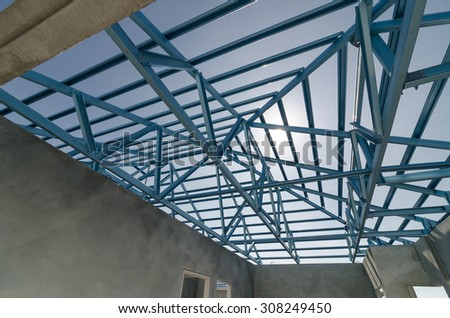 Structure of steel roof frame for construction. - stock photo