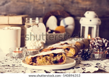 . Christmas homemade pastry. Apple strudel (pie) with dried fruits ...