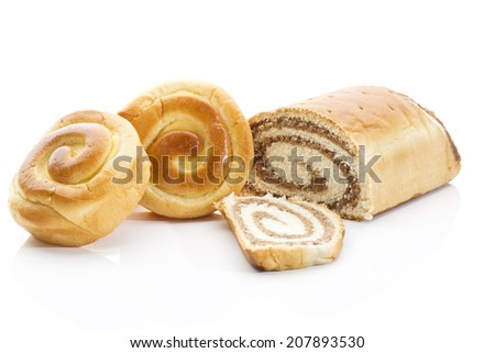 Strudel filled with nuts buns filled with cream on white background