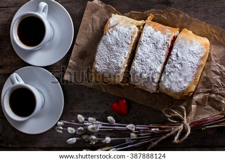 Strudel or pie with cranberries and cheese and two cups of coffee - stock photo