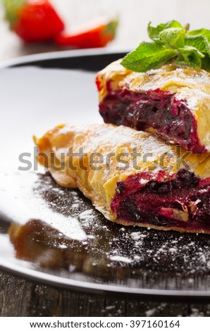 Strudel with blackberry close-up