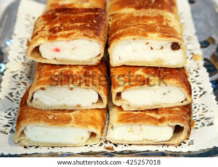 Strudel with curd cheese and raisins on plate at rural retail market   - stock photo