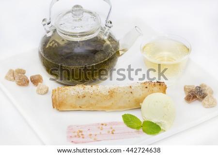 strudel with ice cream and tea - stock photo