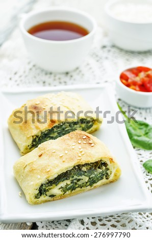 strudel with spinach and ricotta on a white background. the toning. selective focus - stock photo