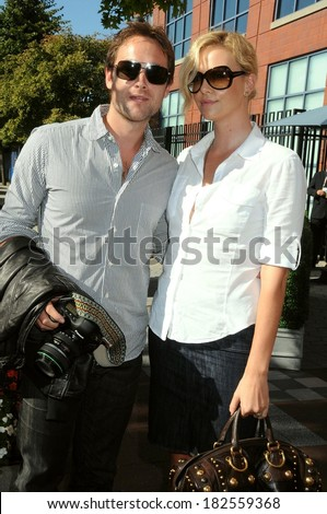 Stuart Townsend, Charlize Theron in attendance for SUN - US OPEN Tennis Tournament, USTA Billie Jean King National Tennis Center, Flushing, NY, September 07, 2008