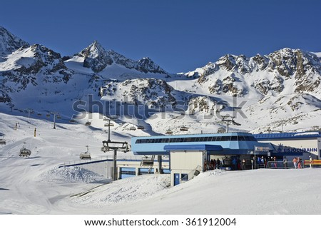 STUBAI, TIROL, AUSTRIA - DECEMBER 23: Unidentified people and cable car mountain station on ski resort Stubaier glacier in Tirol, on December 23, 2015 in Stubai, Austria