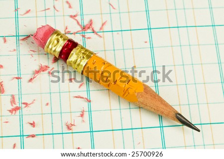 Stubby pencil on accounting ledger paper - stock photo