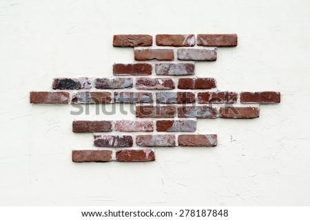 Stucco and brick wall. - stock photo