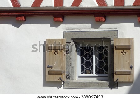 Stucco building with hipped roof