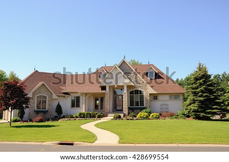 Stucco Modified One Story Rambler House in a Suburban Neighborhood - stock photo