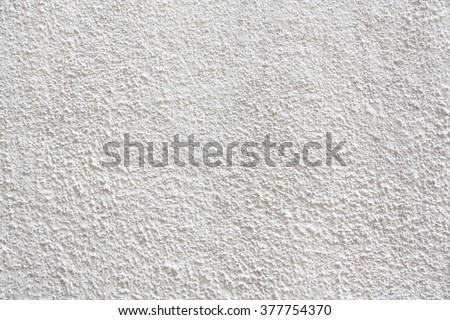 Stucco wall - White stucco textured wall background with natural light.
