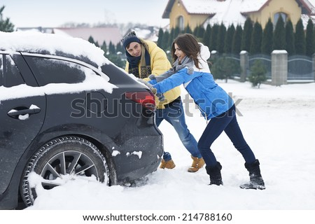 Stuck car in snowdrift is big problem for us   - stock photo