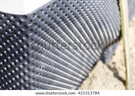 studded film on the wall - new building or home construction - stock photo