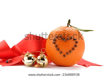 Studded oranges ad red ribbon - stock photo