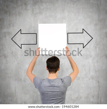 Student and arrows 'left or right'  - stock photo