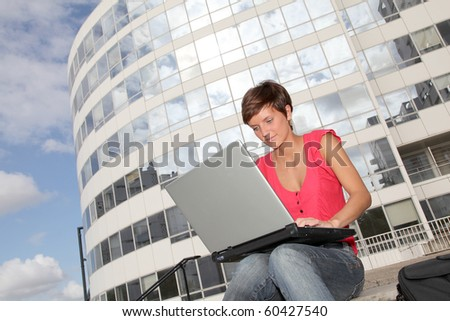 Student at college campus with laptop computer - stock photo