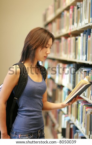 student at the library - stock photo