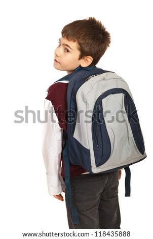 Student boy with  bag looking back over shoulder  isolated on white background