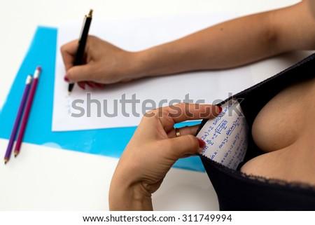 student cheating during exam - stock photo
