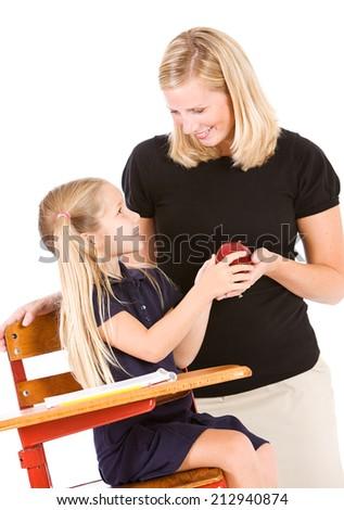 Student: Cheerful Girl Student Gives Teacher An Apple - stock photo