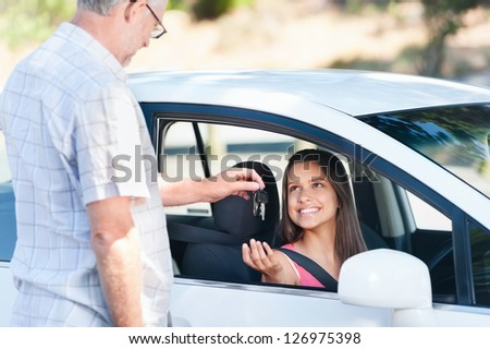 Student driver passes exam and instructor passes her keys