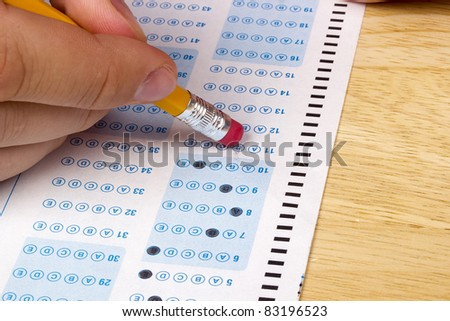 Student erasing a mistake he made on a test.
